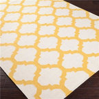Ironwork Trellis Dhurrie Rug, Ivory and Sunflower Yellow - This rug is colorful yet still slightly understated because the yellow is sort of mellow. It is a safe choice for those who might be a little shy of color.