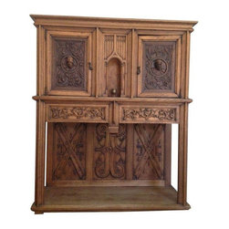 Pre-owned Hand Carved Rectory Cabinet - An impressive hand carved oak rectory cabinet. This cabinet has a presence full of history and intrigue. Its hand carved details really make it stand out. This antique piece would make a wonderful bar or dining room buffet.