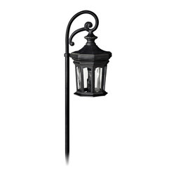 "Hinkley - Traditional Hinkley Raley Collection Museum Black Low Voltage Path Light - From Hinkley this decorative light is ideal for path lighting or for use in flower beds. A single fixture glows warmly within this lantern-style design. This landscape light features a museum black finish and clear water glass. Offers a light spread of 10 feet. Use with your existing low voltage landscape lighting systems. Cast aluminum construction. Museum black finish. Clear water glass. Includes one 18 watt wedge base bulb. 22"" high. 5 1/2"" wide.  Cast aluminum construction.   Museum black finish.   Clear water glass.   Includes one 18 watt wedge base bulb.   22"" high.   5 1/2"" wide."