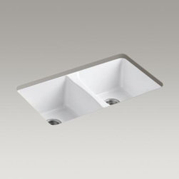 Deerfield® Double Bowl Undermount Kitchen Sink - The updated transitional design has a distinctive hourglass divider and nearly 20% more basin space than the original model. The rear-drains are positioned to not only provide more flat space in the bowl, but also increases the space under the cabinet by moving the plumbing to the back. Crafted from enameled cast iron, this sink resists scratching, burning, and staining for years of beauty and reliable performance.