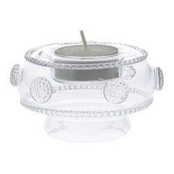 "Juliska - Juliska Isabella Tea Light-Vase Clear - Juliska Isabella Tea Light/Vase Clear. This fetching vessel graces any nook that needs a bit of candlelit sparkle. Turn it over and - voila! - it becomes a petite vase ideal for spray roses and single blooms. Its versatility and charm make it an enduring favorite as a gift or stylish household staple piece. Dimensions: 2"" H x 3.5"" W Capacity: 4 oz"