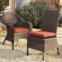 "Torrey All-Weather Wicker Dining Armchair, Set of 4, Espresso - The gracious style of 20th-century garden furniture is echoed in this dining chair with its rolled arms and curved back. Made from a durable synthetic, it's maintenance-free, so you can dine outdoors without a care. Click to read an article on {{link path='pages/popups/torrey-care_popup.html' class='popup' width='640' height='700'}}recommended care{{/link}}. Armchair: 28"" square, 34"" high Side Chair: 20"" wide x 24"" deep x 38.5"" high Frame crafted of welded aluminum and handwoven all-weather wicker. Handwoven wicker is stained Espresso. Chairs each include a quick-drying seat cushion with a water-repellent polyester canvas slipcover in Natural; imported. Get a colorful update with additional slipcovers (sold separately) in water-repellent, ring-spun polyester canvas, or fade and stain-resistant Sunbrella(R) fabric; imported. Sunbrella(R) cushions and slipcovers are special order items which receive delivery in 34 weeks. Please click on the shipping tab for shipping and return information. View our {{link path='pages/popups/fb-outdoor.html' class='popup' width='480' height='300'}}Furniture Brochure{{/link}}."