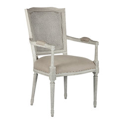 Kathy Kuo Home - French Country Ethan Painted Gray Caned Back Dining Chair - Our parker grey finish is accented by a rich linen seat and open cane back. Constructed from birch each frame is carved and then hand painted in our parker grey which is a blend of grey and beige hues. Seat cushion is hand tied springs which delivers a firmer seat lasting much longer than your basic stuffing. The chair is finished with dark Linen with burlap accents on back, rusted nails hold the fabric in place. Exposed nail heads lend to a more uneven edge appearance and bumps, unevenness and roughness should be expected.