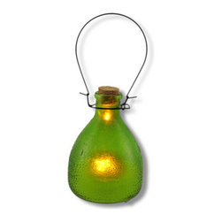 Glass LED Flickering Candle Lantern Green - Add a bit of country chic with this unique lantern. The flickering candle looks like it`s melting right inside the jar! It has a raised pattern on the outside of the glass designed to appear warm to the touch. Hang it from a hook in your garden, or set several on a table for a fanciful candlelit dinner. The options are endless. Uses one CR2032 lithium cell 3 volt battery (included) for worry free `burning`. The lantern is 5 1/2 inches tall, 9 inches tall with the metal handle and 4 inches wide.
