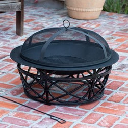 Fire Sense Oak Park Fire Pit - Accent your wrought iron furniture with the gorgeous Fire Sense Oak Park Fire Pit. Perfect for colder and warmer weather usage your family will love spending time outside around the fire -Mantels Direct