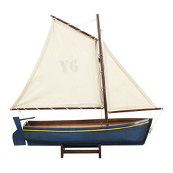 "Inviting Home - Madeira Y6 Yacht Model (blue) - Blue Madeira Y6 yacht model; 17-3/4""L x 3-3/8""W x 16-3/8""H Lateen rigged they recall a sunny day on a Portuguese beach. Madeira yacht model is colorful and hand-carved from a solid block of wood. This yacht model has slightly antique finis and is perfect for nautical home decor. Available in 3 colors * some assembly required"