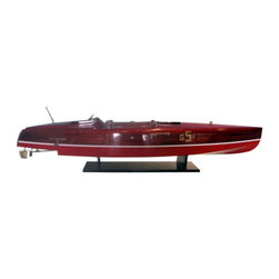 Handcrafted Nautical Decor - Baby Bootlegger Limited 35'' - SOLD FULLY ASSEMBLED--Ready for Immediate Display - Not a Model Ship kit--Exquisitely crafted with precision detailing, this model speedboat of the sleek wooden-hulled Baby Bootlegger racing boat will take you back to the luxurious pleasures of powerboat racing across the lake. Feel as if youeere speeding across the water with the wind in your hair with this powerboat model of the classic mahogany hulled Baby Bootlegger speedboat.----35'' Long x 9'' Wide x 8'' High (1:13 scale)------    Accurate scale      replica model      powerboat of the Baby Bootlegger--    Individual hull planks used for plank-on-frame construction--    Dual cockpits finely crafted and trimmed with leather-lined seats--    Heartwood Honduran mahogany used for hull construction just like real Baby Bootlegger powerboat--    Rare high-quality woods such as birch, maple and yellow siris also used for construction--    Amazing Details, including:--    --        Leather lined seats--        Engine compartment doors open--        Real brass and stainless steel fittings (not plastic parts)--        Authentic gauges and dials on dash (not decals or stickers)--        Individual decking planks visible--        Highly polished finish with multi-layered micro-sanded varnish--        Stearing wheel, deck fixtures and other details--        --    --    --    Sturdy wooden base included with speedboat model--    --    Meticulously painted to match the real Baby Bootlegger powerboat--    --    Limited      production run of these Baby Bootlegger powerboat models--    Extensive      research of      drawings, original plans, photographs and the actual ship ensures the      accuracy of this Baby Bootlegger speedboat model----