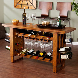Southern Enterprises - Southern Enterprises Syrah Riddling Wine Console Table Multicolor - HN5165-2 - Shop for Wine Bottle Holders and Racks from Hayneedle.com! Show off your exquisite taste in wine and furniture with the Syrah Riddling Wine Console Table by Southern Enterprises. This all encompasing furniture piece holds up to 30 wine bottles. Interior shelves hold 12 bottles each leg panel holds 9 bottles. Top interior shelf has a built in stemware rack to keep your wine glasses handy. This is a great entertainment piece for wine lovers. Acts not only as a wine table useful as a kitchen island breakfast table or server. Thick wood is solid poplar with birch veneer with subtle black distressing for a vibrant rich look. Overall dimensions: 54W x 17.25D x 30.25H inches. Some assembly required. Additional dimensons: Top shelf: 10.5W x 9.75D x 3H inches. Bottom shelf: 10.5W x 9.75D x 13.5H inches. Height Under Bottom Shelf: 5.25 inches. Height under Counter Overhang: 27.75 inches About SEI (Southern Enterprises Inc.)This item is manufactured by Southern Enterprises or SEI. Southern Enterprises is a wholesale furniture accessory import company based in Dallas Texas. Founded in 1976 SEI offers innovative designs exceptional customer service and fast shipping from its main Dallas location. It provides quality products ranging from dinettes to home office and more. SEI is constantly evolving processes to ensure that you receive top-quality furniture with easy-to-follow instruction sheets. SEI stands behind its products and service with utmost confidence.