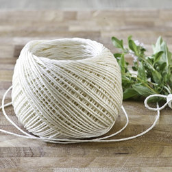 Linen Butcher's Twine - A ball of good butcher's twine will go a long way in the kitchen. Use it to tie roasts and keep your turkey's legs in place while roasting.