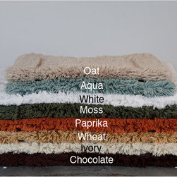 None - Egyptian Cotton Non-slip 18 x 25 Bath Rug - This soft bath rug adds a comfortable element to your bathroom. Made of Egyptian cotton, it is soft against bare feet, and it comes with a no-slip backing that makes stepping out of the shower safer. The solid color blends well into most decor.