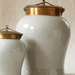 White Crackle Jar with Bronze Lid - Large - Its crackle texture gives the appearance of age and wear but the shine from its white glaze assures that this piece is wonderfully new and beautiful. A shimmering bronze lid accompanies the piece and truly tops the large jar off in style. An absolute must for any transitionally themed space, place this darling jar on a shelf or mantle and bask in its serene elegance.