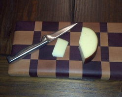 Butcher Blocks - Mini size cutting board for veggies, cheeses or just when a smaller board is needed.  Larger sizes available.  This is an end grain hard maple and purpleheart woods sealed with foodsafe oil.