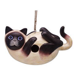 Songbird Essentials - Siamese Cat on Back Birdhouse - Songbird Essentials adds color and whimsy to any garden with our beautifully detailed wooden birdhouses that come ready to hang under the canopy of your trees. Hand-carved from albesia wood, a renewable resource, each birdhouse is hand painted with non-toxic paints and coated with polyurethane to protect them from the elements. By using all natural and nontoxic components Songbird Essentials has created a safe environment complete with clean-out for our feathered friends.