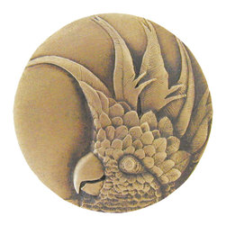 "Inviting Home - Large Cockatoo Knobs - right (antique brass) - Hand-cast Large Cockatoo Knob - right in antique brass finish 1-7/8"" diameter Product Specification: Made in the USA. Fine-art foundry hand-pours and hand finished hardware knobs and pulls using Old World methods. Lifetime guaranteed against flaws in craftsmanship. Exceptional clarity of details and depth of relief. All knobs and pulls are hand cast from solid fine pewter or solid bronze. The term antique refers to special methods of treating metal so there is contrast between relief and recessed areas. Knobs and Pulls are lacquered to protect the finish. Alternate finishes are available. Detailed Description: If you are intrigued by fashionable and playful accessories than you will love the Cockatoo pulls - they come in vertical and horizontal options which would bring amazing variety without having to search at all. You can use the vertical pulls on the cabinet doors and the horizontal pulls on the drawers. If you have any smaller drawers you could also work in the Cockatoo Knobs making it a complete collection while displaying variety."
