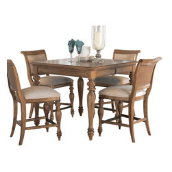 American Drew - American Drew Grand Isle 7 Piece Counter Dining Room Set in Amber - The Grand Isle Collection is a lifestyle bedroom and dining room group that offers high end, yet casual up to date tropical style with multiple options for any room of the home; creating a collection that is perfect for many homes, vacation homes or even smaller size vacation condos. The amber finish has a warm overtone with subtle dark burnished accents that make the natural soft distressing show through. Design elements used in Grand Isle include carved and shaped pilasters, woven drawer fronts and a louver motif; all adding a higher end look to the collection. This collection is sure to add a relaxed, yet sophisticated style to most homes and offers plenty of options to help with storage and organization.
