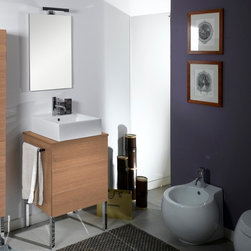 Iotti - 24 Inch Bathroom Vanity Set - Compact, stylish and hardworking, this vanity set's contemporary lines will please the eye and last for years. Available in Glossy White, Wenge, Gray Oak and Natural Oak finishes, the vanity cabinet's raised white ceramic sink and push-to-open drawers combine easy use with novel looks. The high-tech, five layered mirror has scratch and corrosion resistance built in. Let this elegant Italian import be the heart of your half bath or powder room. Set Includes: . Vanity Cabinet (2 drawers). Vessel ceramic sink (18.1 inch x 5.5 inch x 18.1 inch ). Mirror (20.6 inch x 27.7 inch ). Vanity Light (11.8 inch ). Vanity Set Features:. Vanity cabinet made of engineered wood. Cabinet features waterproof panels and push to open drawers. Available in Natural Oak (as shown), Glossy White, Wenge, Gray Oak. Cabinet features 2 drawers. Faucet not included. Perfect for modern bathrooms. Made and designed in Italy. Includes manufacturer 5 year warranty.