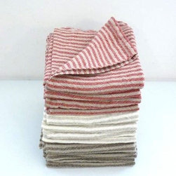 Linen Towel - How luxe is a bath towel made of linen? Nothing sounds better after a cool shower on a hot summer day. The worn earthy colors of these striped towels look like they would only improve with age.