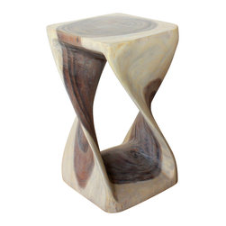 Kammika - Twist Stool Sust Wood 12 in SQ x 20 inch Hgt w Eco Friendly Livos Agate Grey Oil - Our Sustainable Monkey Pod Wood Twist Stool 12 inch x 12 inch x 20 inch height with eco friendly, natural Livos Agate Grey Oil Finish is hand carved from sustainable wood and completely eco-friendly. The beauty of this design lies in its simplicity; it is bold, yet gentle, rustic, yet refined. One quarter twists support this elegant piece, which can serve as an end table, display stand, or stool. Carved from a single piece of Monkey Pod wood, these eco friendly functional art pieces are appealing to the viewer from any angle. The oil makes the wood turn to an antique white look with a light grey patina finish. The light portions of wood turn to shades of beige, and the dark wood lightens to shades of brown with a light transparent grey top coat over the white antique looking undercoat. There is no oily feel and cannot bleed into carpets, as it contains natural lacs. Made from the branches of the quick-growing Acacia tree in Thailand, where each branch is cut and carved to order (allowing the tree to continue growing), the wood is dried, carved and sanded creating a beautiful, sturdy and sustainable place to sit. We make minimal use of electric hand sanders in the finishing process. All products are dried in solar or propane kilns. No chemicals are used in the process, ever. All products finished by hand rubbed oils. After each eco friendly piece is carved, kiln dried, sanded, and hand rubbed with eco friendly, natural Livos Oil, they are packaged with cartons from recycled cardboard with no plastic or other fillers. As this is a natural product, the color and grain of your piece of Nature will be unique, and may include small checks or cracks that occur when the wood is dried. Sizes are approximate. Products could have visible marks from tools used, patches from small repairs, knot holes, natural inclusions or holes. There may be various separations or cracks on your piece when it arrives. There may be some slight variation in size, color, texture, and finish color.Only listed product included.