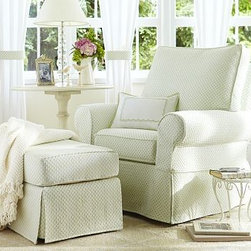 Comfort Swivel Glider & Ottoman - Nobody does a classic rocker like Pottery Barn. With a sturdy and eco-friendly construction, this structure is so unbelievably comfortable--and elegantly covered to look great for years to come. A necessity for comfortable feeding and cuddling.