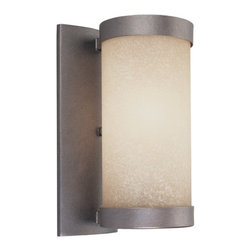 Dolan Designs Lighting - Single-Light Sconce - 2626-66 - Sconces are the easiest way to dress-up any interior space without significantly changing decor. This sconce boasts a cylinder of luxurious caramelized glass that emits a flattering light when lit. A lush vista finish adds a sophisticated touch and enriches the glass. Takes (1) 100-watt incandescent A19 bulb(s). Bulb(s) sold separately. UL listed. Dry location rated.