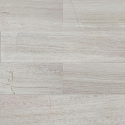 White Birch Plank Tile 12x24 - The natural grey striations on a background of soft grey Limestone emulate the naturally beauty of the iconic birch tree. Whether in a soothing spa bathroom or an elegant main room, Birch will make any space, contemporary or classic, feel refined. Available in two sizes, in honed or polished finish.