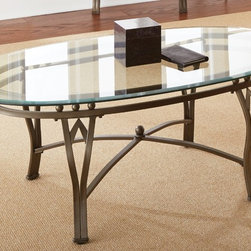 None - Maison Glass-top Oval Coffee Table - The Maison oval coffee table will be the perfect accent for your living room. The nutmeg brown metal base features gently curved legs and an arched cross stretcher. Decorative round finials enhance the table base.