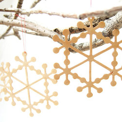 Delicate Wooden Snowflake Christmas Tree Ornament by Quite Alright - Ingrid Shwaiko's handmade wooden snowflakes are almost as delicate and original as the real thing. They'd be the perfect touch for a Scandinavian tree.