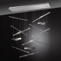 AXO Light - Explo Medium Suspension by AXO Light - Light and color bursts forth from the AXO Light Explo Medium Suspension. It uses three light sources to cast bright light up and down. This light flashes on the surrounding array of hand-made Murano glass bars, available with white or red interiors. Field-cuttable cables allow you to customize the configuration of the bars and height of the light sources. Italy's AXO Light combines traditional Venetian glasswork and artisan craftwork with avant-garde lighting techniques and innovative materials. Their design philosophy is clear: use creativity and inspiration to create stunning lighting replete with value and emotion.