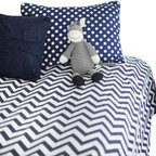 "New Arrivals Inc. - Chevron Navy Zig Zag Kids Bedding - Inspired by the popular chevron pattern, the Chevron Navy Zig Zag Kids Bedding Set by New Arrivals Inc. is fun for a new big girl or boy room!  Gray and white give a clean modern look to the room. Create a modern, yet sophisticated room by adding whimsical accessories and room decor items.  Choose from Duvet Cover or Coverlet.The front is Zig Zag in Slate and the back is flannel. The Duvet Cover has a zipper enclosure. The Duvet is not included.The Twin Size measures 68"" x 88"". The Full/Queen Size measures 88"" x 88""."