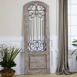 Uttermost - Uttermost Mulino Distresed Wall Panel - 27W x 75H in. - 13861 - Shop for Curtains and Drapes from Hayneedle.com! The Uttermost Mulino Distresed Wall Panel - 27W x 75H in. isn't an actual entryway but it'll lead your space to a more romantic destination. Made of solid wood and washed with a distressed light taupe-gray paint wash it appears to be the way out into the garden of your dreams. The middle of the door is decorated with hand-forged naturally rusted metal scrollwork detailing.About UttermostThe mission of the Uttermost Company is simple: to make great home accessories at reasonable prices. This has been their objective since founding their family-owned business over 30 years ago. Uttermost manufactures mirrors art metal wall art lamps accessories clocks and lighting fixtures in its Rocky Mount Virginia factories. They provide quality furnishings throughout the world from their state-of-the-art distribution center located on the West Coast of the United States.