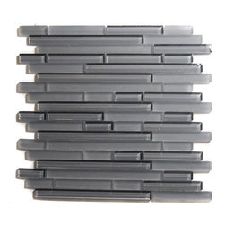 "GlassTileStore - Tao Concrete Glass Tile - Tao Concrete Glass Tile             The mixture of polished and frosted glass creates a sleek and attractive design to any room. The combination of the blend of polished and frosted glass in shades of gray creates a beautiful modern and contemporary backdrop. The mesh backing not only simplifies installation, it also allows the tiles to be separated which adds to their design flexibility.         Chip Size: 1/2"" x Random   Color: Shades of Gray   Material: Glass   Finish: Polished and Frosted   Sold by the Sheet - each sheet measures 12"" x 12"" (1 sq. ft.)   Thickness: 8mm   Please note each lot will vary from the next.            - Glass Tile -"