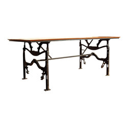 Workshop 152 - Consigned Vintage Industrial Cast Iron Base Dining Table - This table features a graphic cast iron and steel base and a reclaimed Jatoba wood top. Jatoba is an increasingly scarce South American hardwood prized for its dramatic grain, denseness and durability, and was often used as flooring during the first half of the 20th century. With ample leg room at each end, the base doesn't hinder seating in any way, allowing this table to comfortably seat six people. It's important to note that this is a meticulously handcrafted, absolutely one-of-a-kind piece of furniture, not some poorly made mass-produced copy imported from overseas.