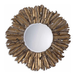 Uttermost - Hemani Antique Gold Mirror - This mirror can't wait to be king of your wall. Made of hand forged and hammered metal, the eclectic piece evokes images of a lion's burly mane. It's finished in antique gold leaf for a truly regal appearance.
