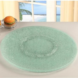 Chintaly 24 in. Sandwich Glass Lazy Susan - Clear - Having the Chintaly 24 in. Sandwich Glass Lazy Susan - Clear doesn't make you lazy -- it makes you smart!. This superbly convenient and stylish lazy Susan is perfect for keeping salt, pepper, napkins, condiments, and other items within reach -- no matter what side of the table your on! Just rotate and grab. Crafted of clear glass, this lazy Susan is bound to last you for years to come.About Chintaly Imports Based in Farmingdale, New York, Chintaly Imports has been supplying the furniture industry with quality products since 1997. From its humble beginning with a small assortment of casual dining tables and chairs, Chintaly Imports has grown to become a full-range supplier of curios, computer desks, accent pieces, occasional table, barstools, pub sets, upholstery groups and bedroom sets. This assortment of products includes many high-styled contemporary and traditionally-styled items. Chintaly Imports takes pride in the fact that many of its products offer the innovative look, style, and quality which are offered with other suppliers at much higher prices. Currently, Chintaly Imports products appeal to a broad customer base which encompasses many single store operations along with numerous top 100 dealers. Chintaly Imports showrooms are located in High Point, North Carolina and Las Vegas, Nevada.