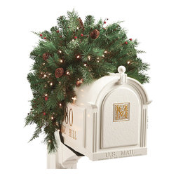 Frontgate - White Pine Cordless Mailbox Christmas Swag - Boughs and berries perfectly mimic nature. Superbright, 5mm LED bulbs are energy efficient and long lasting. Convenient 6-hour timer. Optional manual switch located on the weatherproof battery box. To maximize fullness, greenery will need to be shaped. Wispy cedar and Douglas fir branches and berries, along with pinecones and bright LED lights make our Winter Pine Cordless wreaths and garland truly shine. This lush greenery can be easily programmed to glow at the same time, every day of the week.  .  .  .  . . Operates on D batteries (not included) .