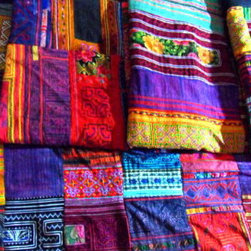 """Hmong Hilltribe patchwork and embroidered throw - Handwoven repurposed printed and embroidered cotton and hemp that is patchworked and sewn by Hmong Hilltribe villagers in Thailand. 100"""" x75"""". Made in Thailand. No two are identical. Each is a one-of-a-kind."""