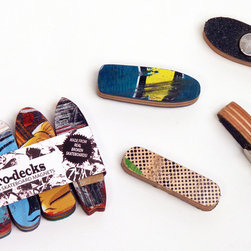 Skateboard Magnets - As functional as they are radical, our new Microdecks are made from real broken skateboards. Every set is unique. Four different precision cut, classic skateboard shapes per set.