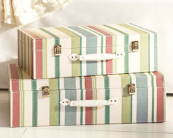 Striped Decorative Luggage - Suitcases are a great space-saving alternative to the trunk, and they can have the same enduring appeal if you go for a classic look. This sunny beach stripe duo will lift any space, and the top case can be used to display photographs or other sentimental items by propping up the lid — throw an old wooden ruler in there to match the vintage feel.