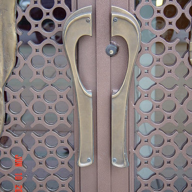 Entrance Doors for Church by Arttig - 6 f x 10 f. Ornamental Iron design doors with custom sculpted and cast in bronze figures.