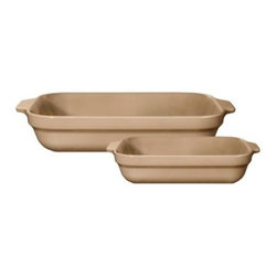 Emile Henry 2 pc. Lasagna Dish Set - Sand - With a friendly sand color and built-in handles your Emile Henry 2 pc. Lasagna Dish Set - Sand will easily go from oven to table side in style. This set includes two versatile baking dishes -- one medium and one individual-sized lasagna baker. In each pan you'll be able to create casseroles, vegetable bakes, macaroni and cheese, and more. They're both handcrafted in France and fired in a high heat-resistant oven. Each has a friendly sand color and translucent glaze that won't crack, discolor, or scratch. Perfect for modern lifestyles, these lasagna pans are made to withstand the freezer, oven, microwave, broiler, and even the dishwasher. About Emile Henry Emile Henry was founded in 1850 and is located in Marcigny, a small town tucked within the province of Burgundy, France. It is still owned and operated by the Henry family. Over the generations Emile Henry has established a world-renowned reputation for creating the finest quality ceramic ovenware, gourmet cooking products, and exceptional bakeware products. Their products include baking dishes and cake stands. The discerning gourmand will recognize the quality in every loaf pan, casserole dish, stew pot, handcrafted pie dish, trivet, tagine, and brazier they create. Emile Henry manufacturers all of their cooking products from clay found in the Burgundy region. Burgundy is noted for their world-famous wines due in part to the mineral-rich limestone soil. It is this soil and clay that go into the special clay cookware crafting formulas that are the basis of all Emile Henry ceramic cookware products.