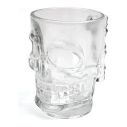 Kikkerland - Skull Stein Pint Glass - The Skull Stein Pint Glass turns your happy hour into an eerie hour. This sturdy beer glass features a human skull-shaped face and bony handle. Perfect for drinking the poison of your choice, be it beer, hard cider, or blood! This beer stein is sure to add to the ambiance of your Halloween party or spooky gathering and looks great on the shelf next to the rest of your pint glasses.