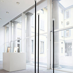 Gino Sarfatti Mod 1095 Floor Lamp by Flos Lighting - Gino Sarfatti Mod 1095 Floor Lamp, Flos Lighting, from Stardust.  An Icon of Italian lighting design returns.   Designed by Gino Sarfatti in 1968, the Model 1095 Floor Lamp from Flos Lighting emits indirect light. Model 1095 is composed of a slate grey painted tubular aluminium stem with small reflective cups painted white which match the aluminium base cover. This statuesque Flos floor lamp illuminates an entire room with cool indirect light. Integrated seamlessly within Sarfatti's classic, stalk-like design is a patented water cooling system that enables powerful LEDs to shine with the same intensity and quality as the halogen bulbs used in the original design. Made in Italy by Flos. The Flos Lighting Model 1095 Floor Lamp is available in 3 sizes.  From Stardust.