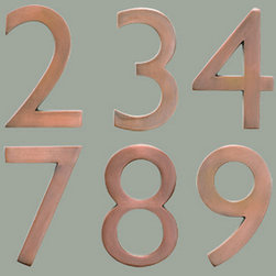 Antique Copper House Numbers - The Solid Cast Brass 5 in. Floating House Numbers offers an elegant hand finish in antique copper. The house numbers can be mounted either flush with the wall or you can leave the mounting screws partially out of the holes for a floating number effect. No holes or unsightly screw heads are shown.