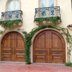 Access custom wood garage doors - This baroque style custom wood sectioncal door is a part of our Architect Series.  The Architect Series inlcudes the use of full hardwood for both the construction of the face and the overlays.  These doors are one-of-a-kind and constructed in house at Access!