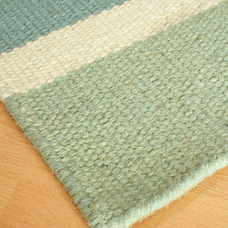 Half Moon Bay Wool Berber Stripe Rug - Wavelets of blue dance sprightly to the shore. Wisps of seagrass flit and flutter in a whispered breeze.  Influenced by the ephemeral beauty of a cherished summer spot, the Half Moon Bay Wool Berber Stripe Rug lends casual refinement with a hint of coastal chic to your decor. A floor treatment that is at once striking yet subtle, the rug is hand-loomed in India and is fully reversible, allowing for easy placement within in a variety of rooms in your home.