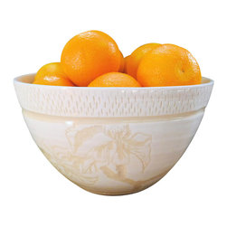 White + White Flower Serving Bowl - This lovely and subtle bowl pictures an ornate floral design in two shades of white. It is an elegant, modern shape and would be wonderfully suited to so many uses, from serving roasted veggies or potatoes to displaying some fruit to brighten any table or counter top.