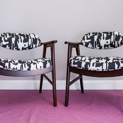 Don & Roger, Pair of Mid Century Modern Armchairs Newly Upholstered - Don & Roger are excellent examples of late mid-century modernism, with clear influence of the biomorphic sub-genre of the style that became increasingly popular throughout the 1960s as both pop art and the space age transformed furniture design.  While the overall form is clearly modern, the designer implemented a number of subtle curves, giving the piece a softer, more organic spirit.  The new upholstery clearly nods to the mid-century as well, in particular the abstract expressionist painters of the 50s.  Both pieces were in fact created to occupy an office building, and one cannot help but envision the workplace being just a bit like Madmen.