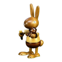 "Alexander Taron - Christian Ulbricht Ornament, Bunny Painting Egg - 4""H x 2.25""W x 2.5""D - Christian Ulbricht/Seiffener Standing Ornaments - Bunny in natural wood finish painting an egg - Made in Germany."