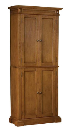 Home Styles - Home Styles Kitchen Pantry in Distressed Oak Finish - Home Styles - Pantry - 500469 -The Home Styles Furniture Oak Kitchen Pantry is constructed of solid hardwood and veneers in a mult-step distressed oak finish. Four doors open to a spacious pantry that includes two adjustable shelves permitting customized storage for greater utility, and the pantry is specifically designed with enough depth to accommodate cereal boxes! with a large storage capacity, the Home Styles Kitchen Pantry is a perfect addition to your dining area or kitchen.