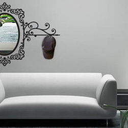 Coat rack wall decals - An elegant baroque removable wall decal, an oval laser cut acrylic mirror and premium matte hooks come together in this classy product. Comes in 5 different sizes - from $48 and up.